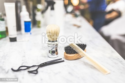 928445950 istock photo Shaving and barber equipment on desk. 1176358194