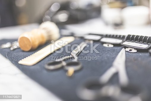 696318954 istock photo Shaving and barber equipment on towel at the desk. 1174470321