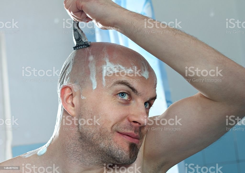 Shaving at home stock photo