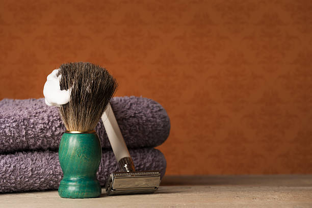 Shaving Equipment on wooden Table and vintage Background Shaving Equipment on wooden Table and vintage Backdrop shaving brush shaving cream razor old fashioned stock pictures, royalty-free photos & images