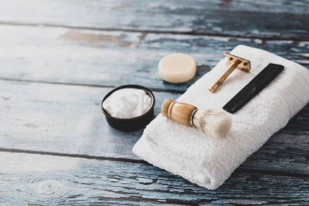 Shaving equipment Shaving equipment on wooden background shaving brush shaving cream razor old fashioned stock pictures, royalty-free photos & images