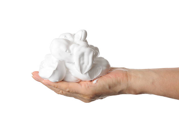 shaving foam on the hand against white background - shaving cream stock pictures, royalty-free photos & images