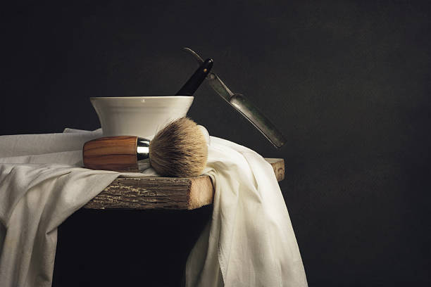 Shaving Tool on wooden Table and dark Background vintage Shaving Tool on wooden Table and dark Background shaving brush shaving cream razor old fashioned stock pictures, royalty-free photos & images