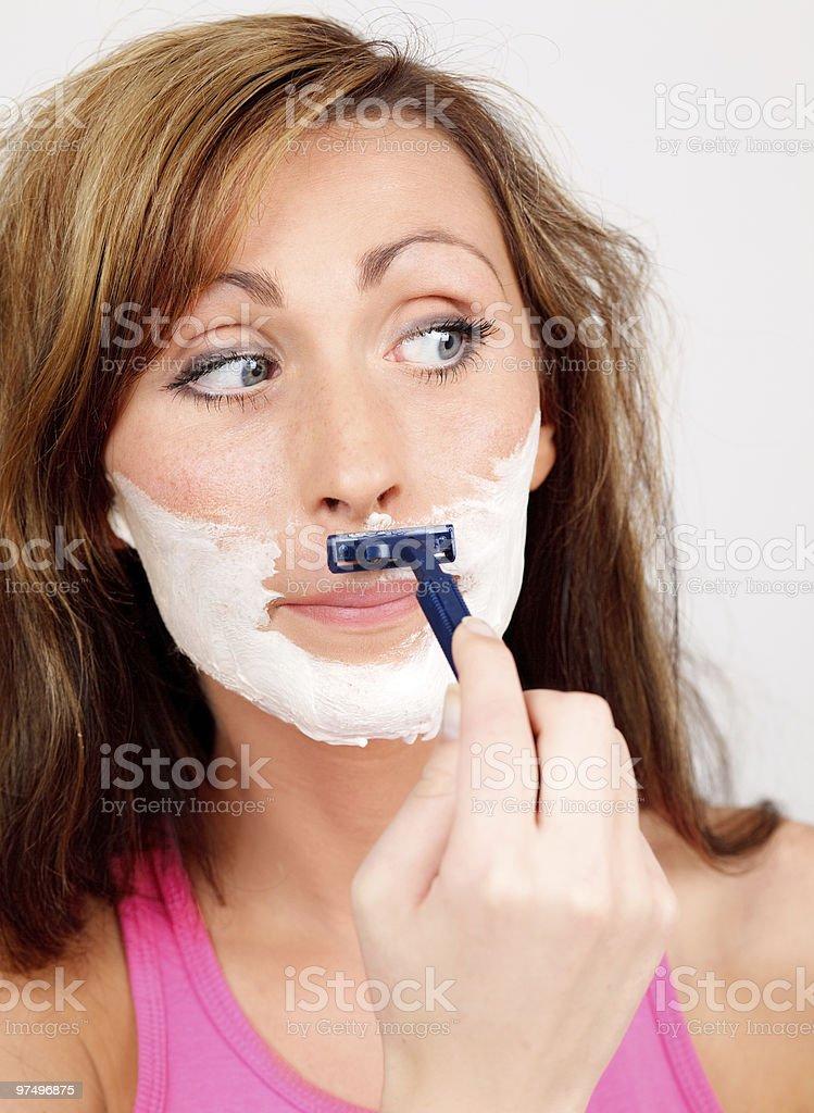 shaving woman royalty-free stock photo