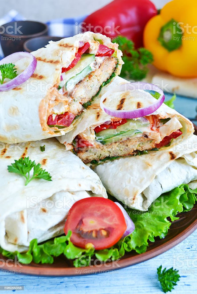 shawarma Lavash with chicken, tomatoes, lettuce and peppers royalty-free stock photo