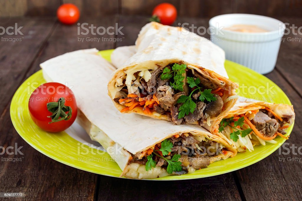 Shawarma sandwich - fresh roll of thin lavash (pita bread) - Royalty-free Arabic Style Stock Photo