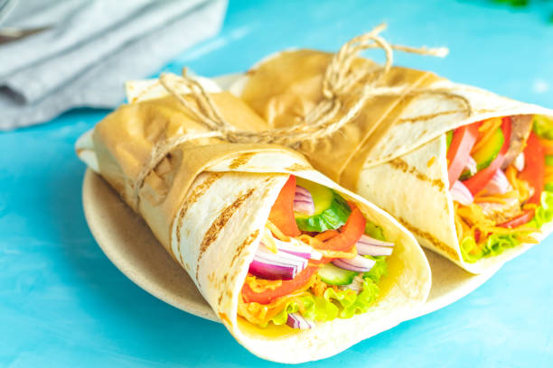 Shawarma sandwich with grilled meat, vegetables, cheese stock photo