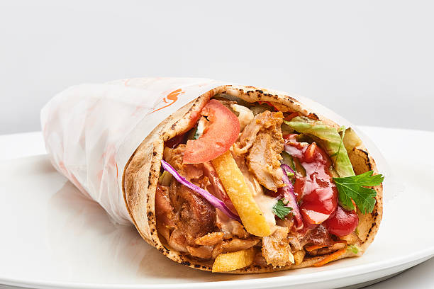 shawarma with sauce on white background stock photo