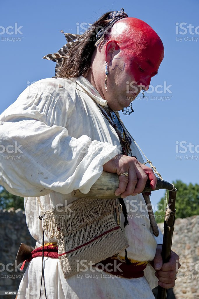 Shawnee Indian Loading Powder Into His Rifle stock photo