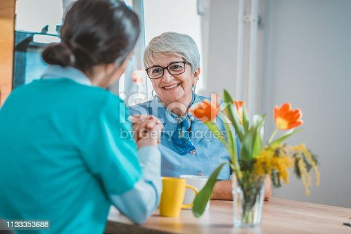 499062115istockphoto She always brings a smile to her patients 1133353688