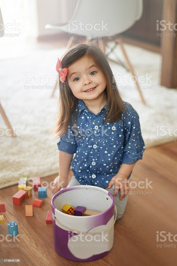 She always cleans up after the playing stock photo