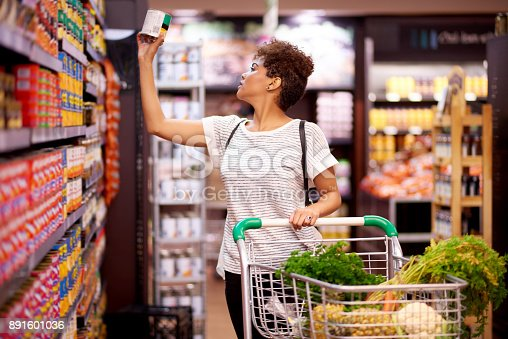 Shot of a young woman shopping in a grocery store