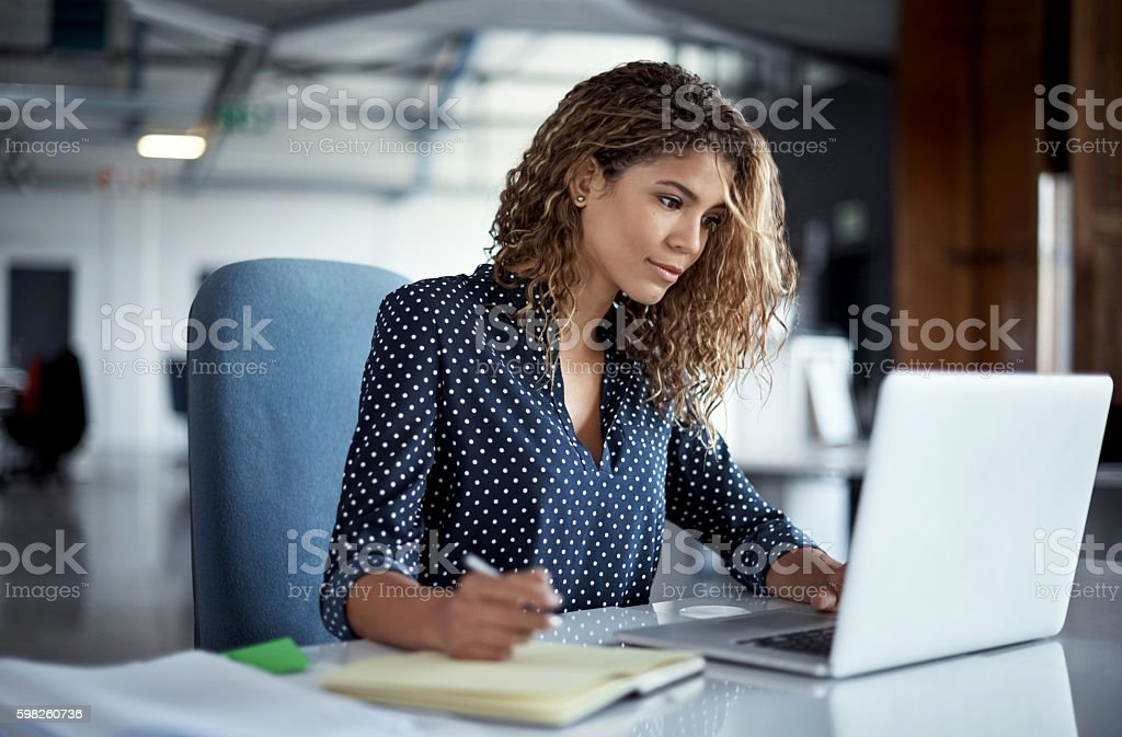 She always gives her job one hundred percent stock photo