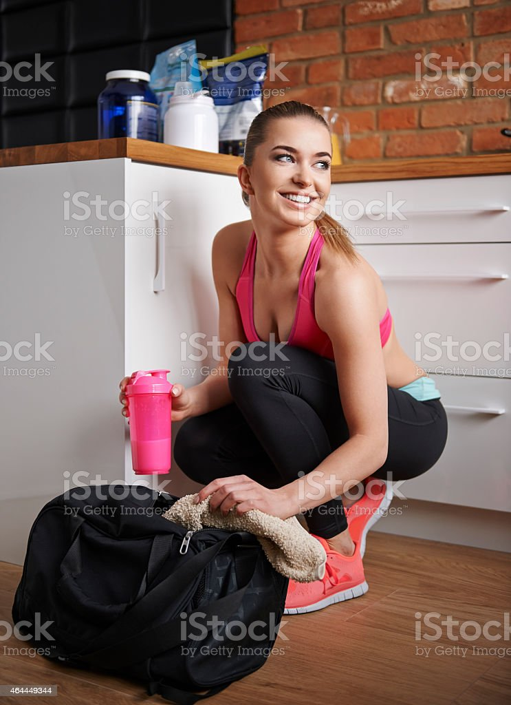 She always has protein drink in her gym bag stock photo