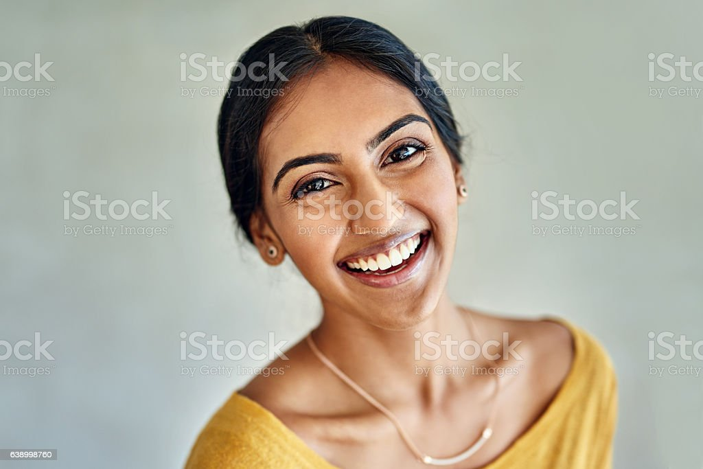 She attracts happiness into her life stock photo