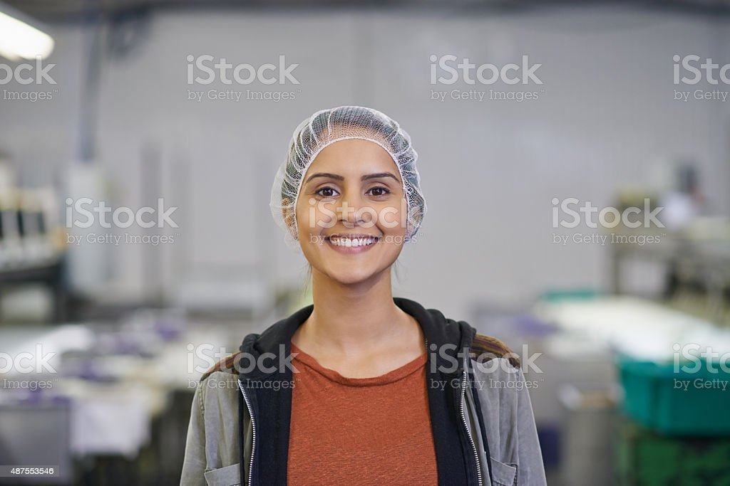 She brings her smile to work every day stock photo
