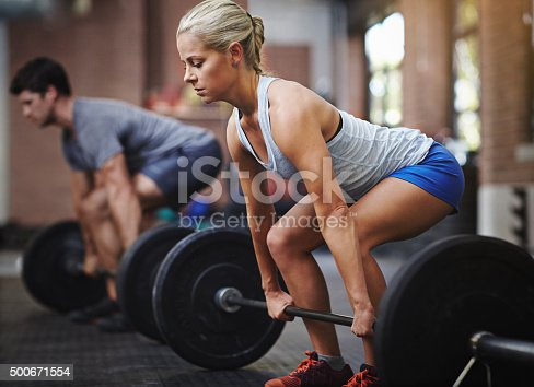 Shot of two people lifting weights in a gymhttp://195.154.178.81/DATA/i_collage/pu/shoots/806094.jpg