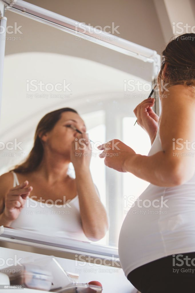 She doesn't miss her beauty routine stock photo