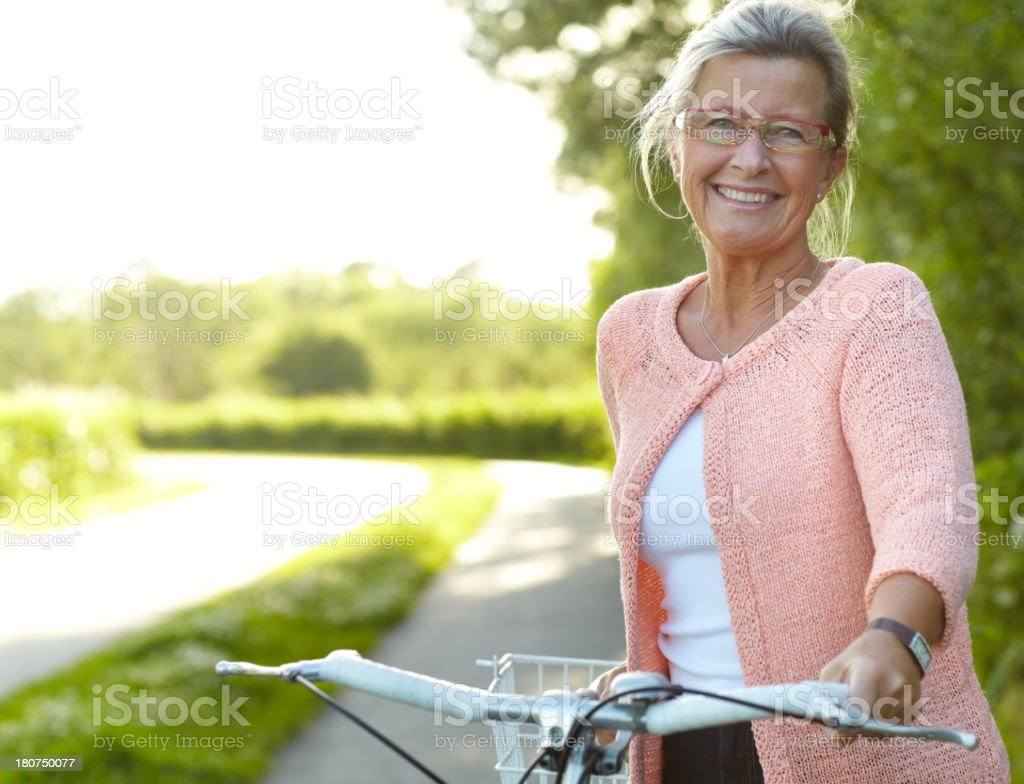 She enjoys healthy outdoor activities - Cycling stock photo