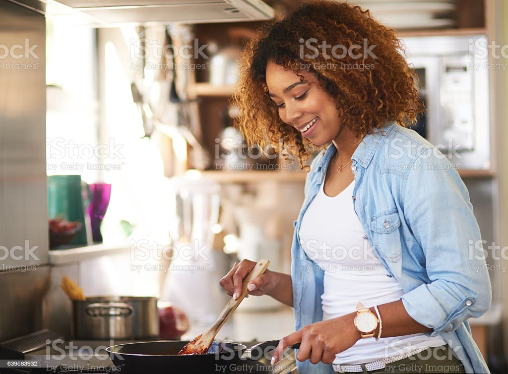 She feels at ease in the kitchen stock photo