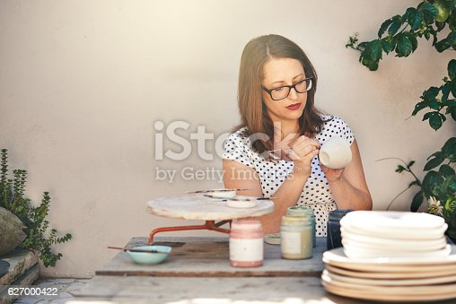 627000458istockphoto She gives every piece her undivided attention 627000422