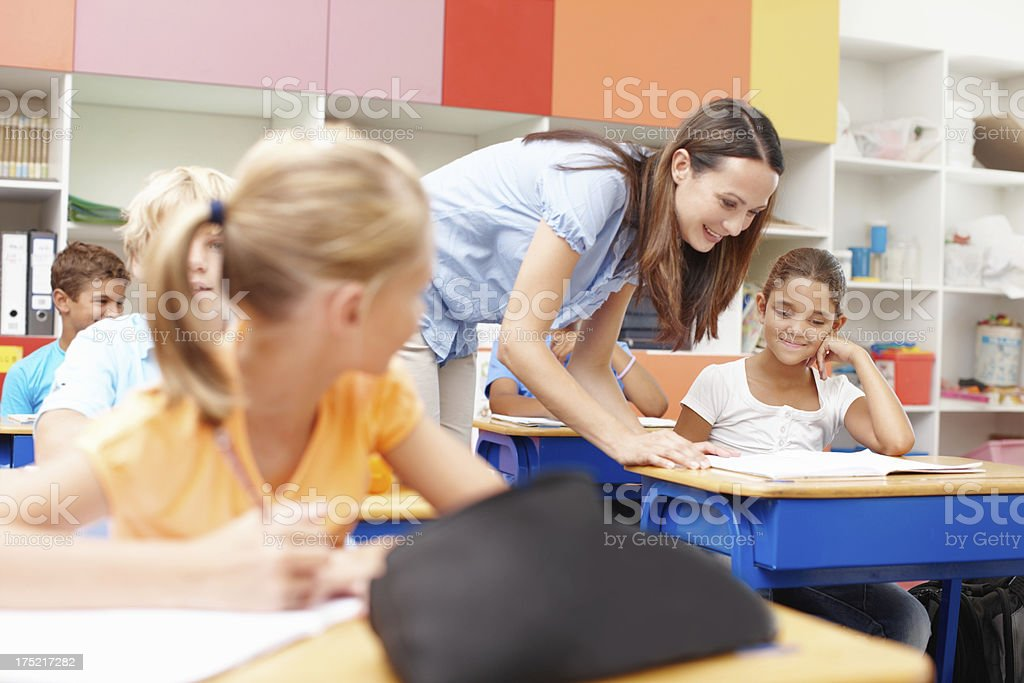 She gives her students individual attention stock photo