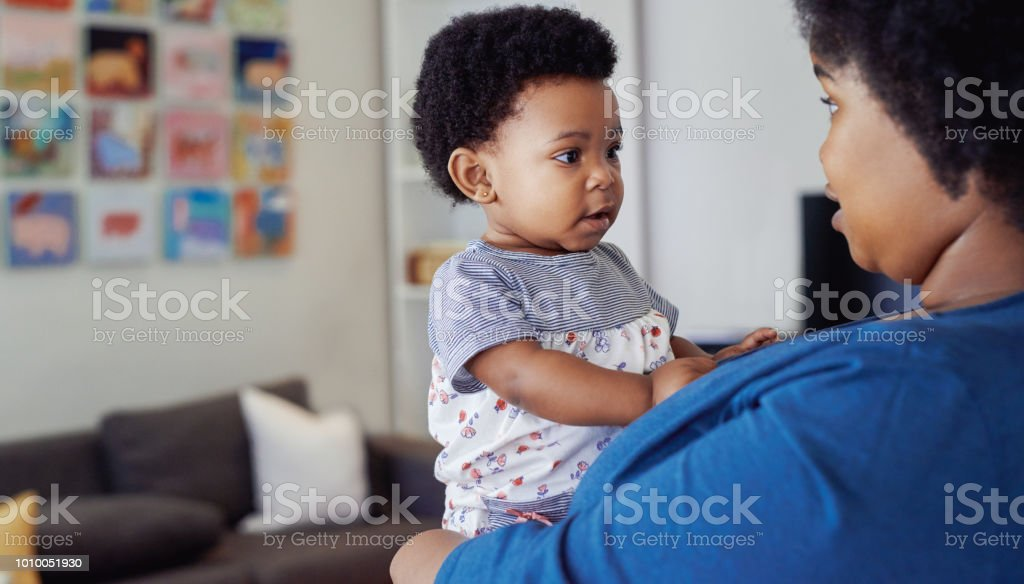 She grows by the day Cropped shot of a young mother spending time with her baby girl Adult Stock Photo