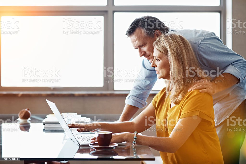 She handles the bills in this home stock photo