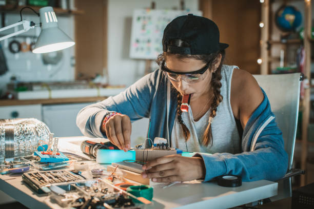 She has a passion for science Teenage girl working on some engineering project at home. leisure equipment stock pictures, royalty-free photos & images