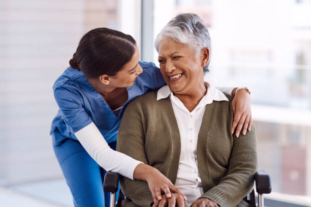 She has a very kind nature with her patients Shot of a young nurse caring for a senior woman in a wheelchair patience stock pictures, royalty-free photos & images