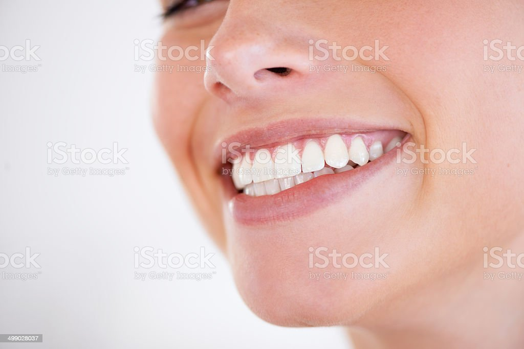 She has every reason to smile stock photo