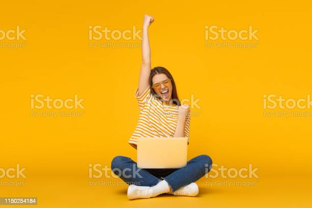 She is a winner excited young female with laptop isolated on yellow picture id1150254184?b=1&k=6&m=1150254184&s=612x612&h=c9ebdpzyuheqfz4drirgfngr8mevszqnt2lx3i7gcva=