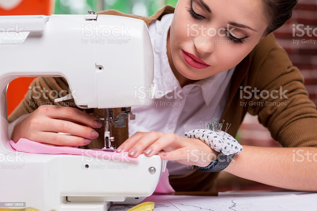 She is an expert tailor. stock photo