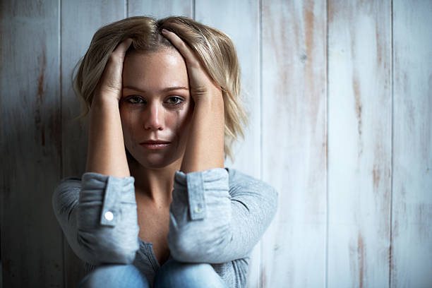 She is at breaking point stock photo