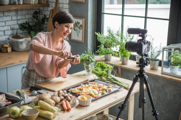 She is enjoying at cooking and vlogging stock photo