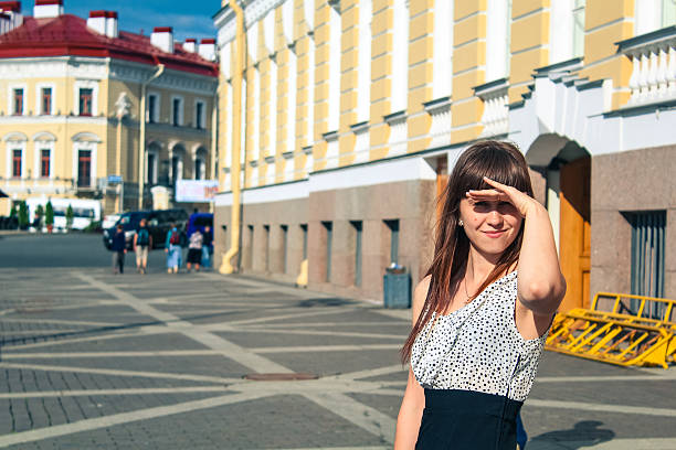 She is looking forward to the sun. Russia. stock photo