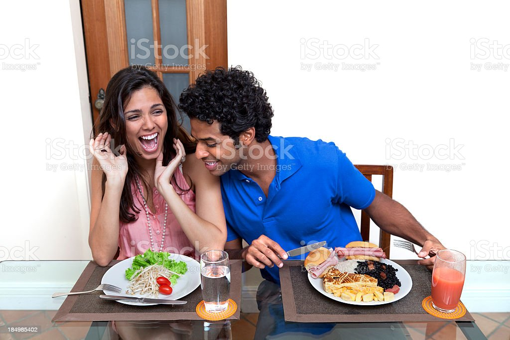 She is on a diet but he can eat everything royalty-free stock photo
