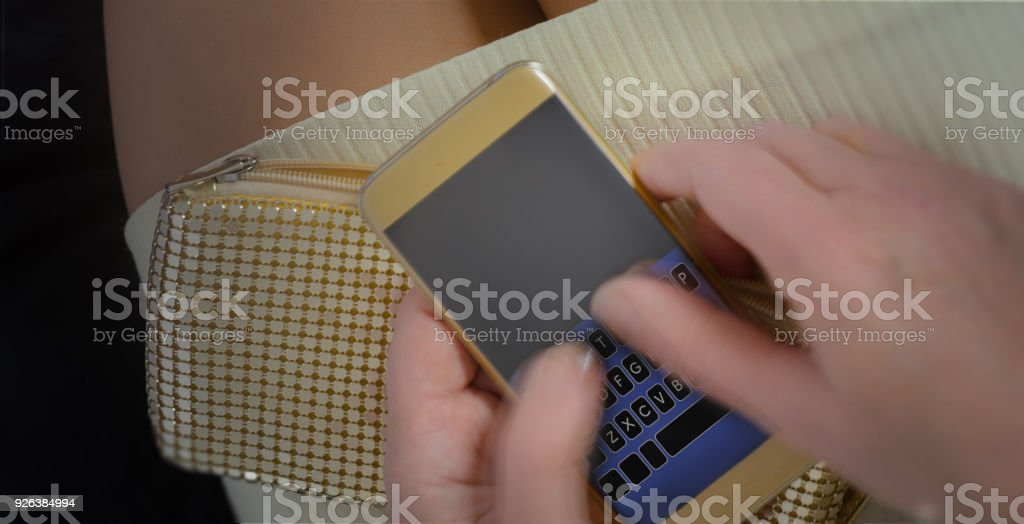 She is texting fast with thumbs in blurred motion stock photo