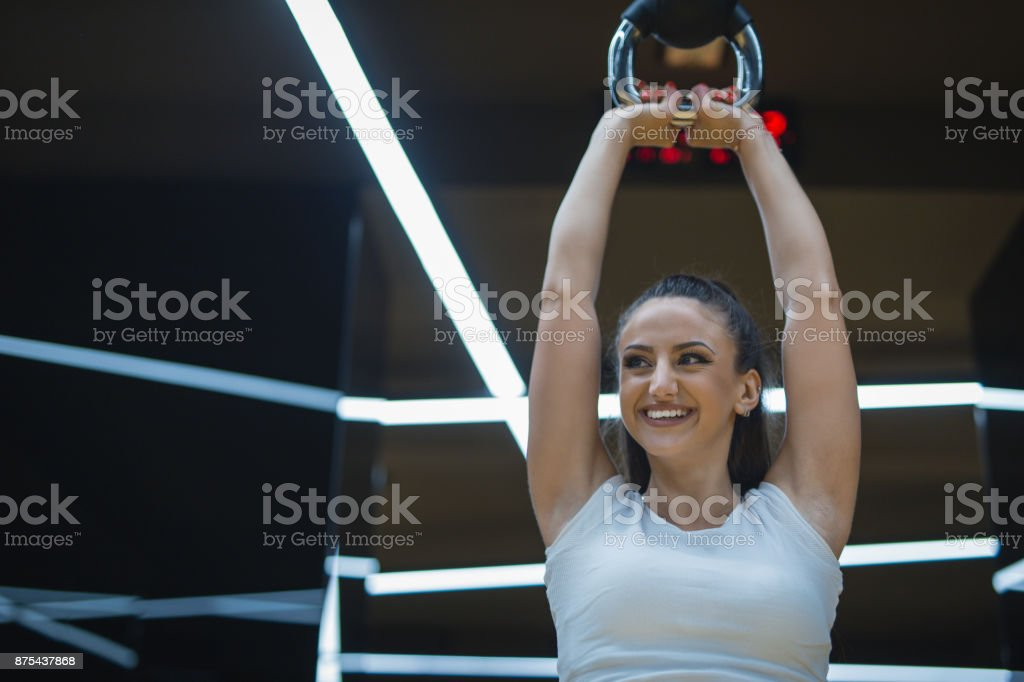 she is training with kettlebell stock photo