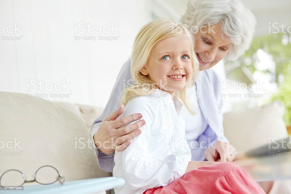 She learns so much from her caring grandmother royalty-free stock photo