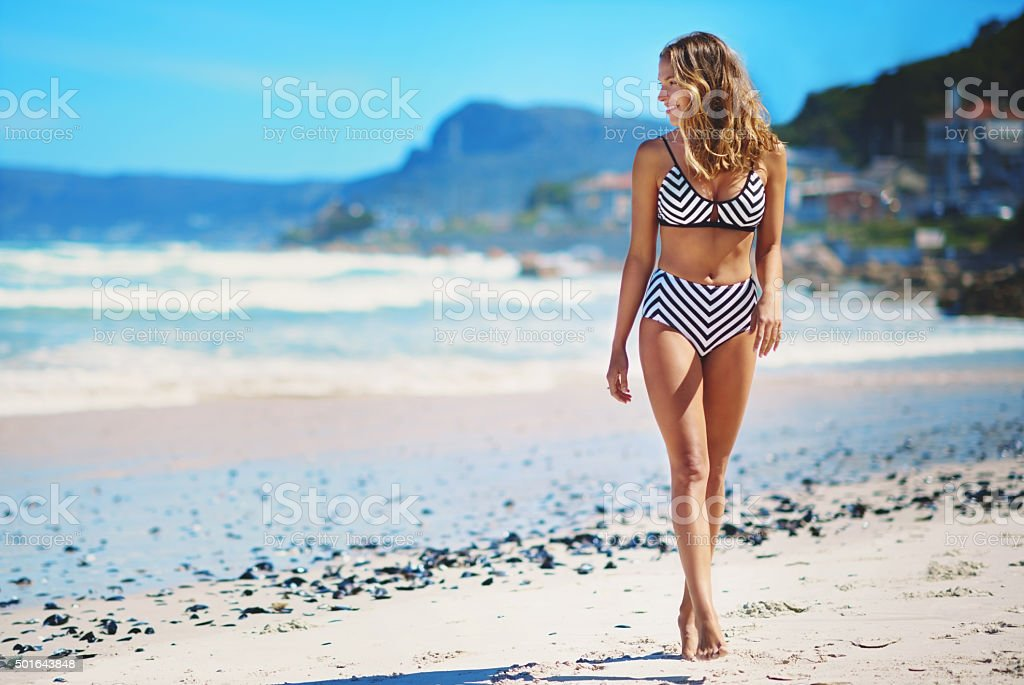 She likes long walks on the beach stock photo