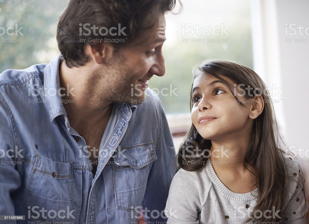 She looks up to her Dad stock photo