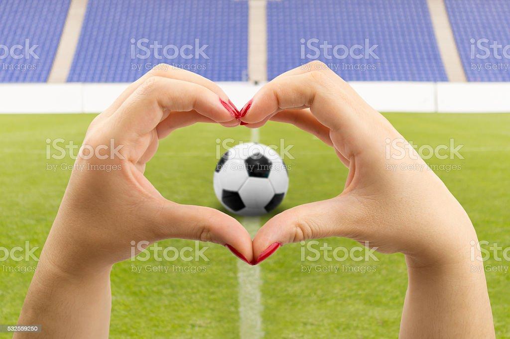 she loves football stock photo