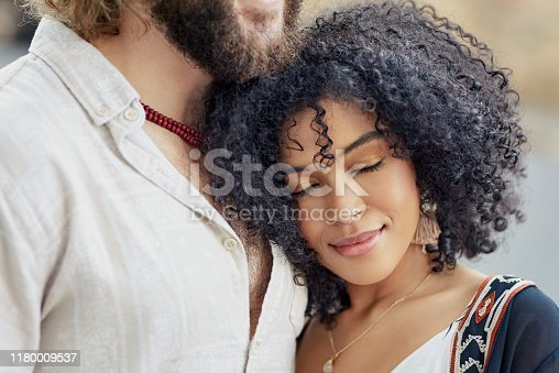 Cropped shot of a woman leaning against her boyfriend's chest