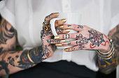 istock She loves her tattoos 518718017