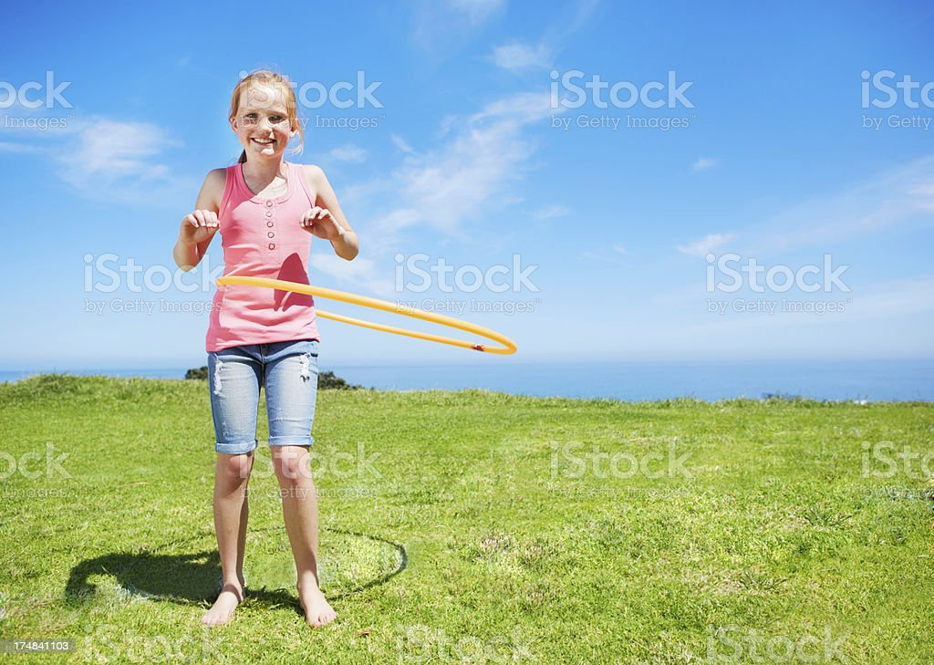 She loves hulahooping royalty-free stock photo
