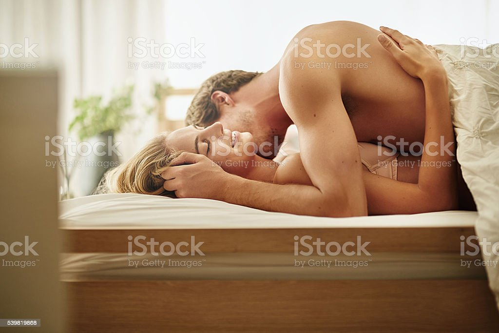 She loves it when he nuzzles her neck stock photo