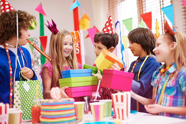 She loves receiving birthday gifts She loves receiving birthday gifts group of friends giving gifts to the birthday girl stock pictures, royalty-free photos & images