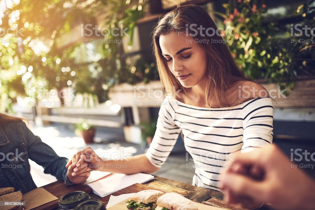 She loves the prayer before the meetings royalty-free stock photo