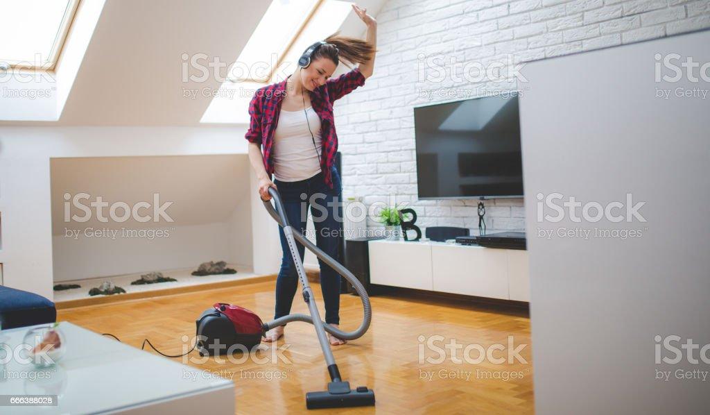 She loves vacuuming stock photo